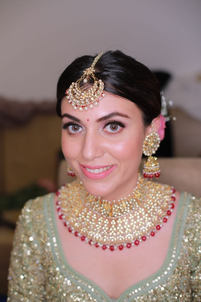 pastel bride   nude makeup look polki jewellery   funny couple moments green sabyasachi lehenga   indian bride groom   wittyvows   bridal lehenga   floral wedding   chomu palace