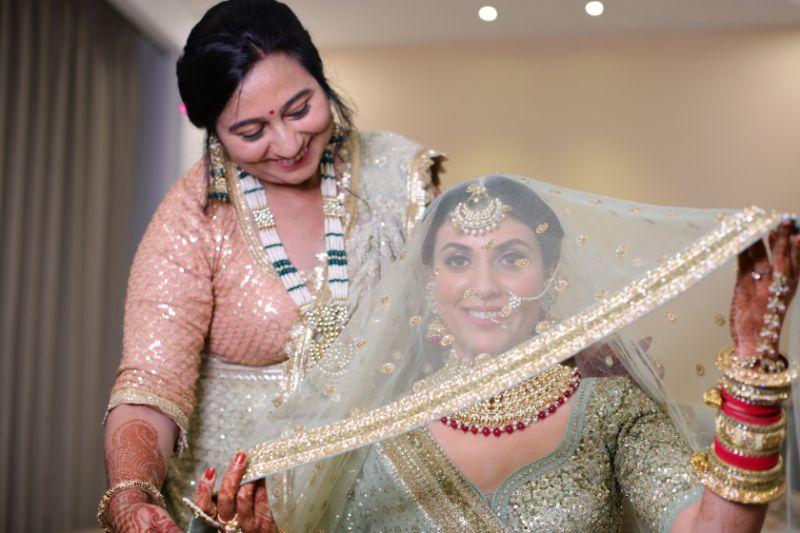 mother daughter moment | green pastel wedding | pastel lehenga | funny couple moments green sabyasachi lehenga | indian bride groom | wittyvows | bridal lehenga | floral wedding | chomu palace