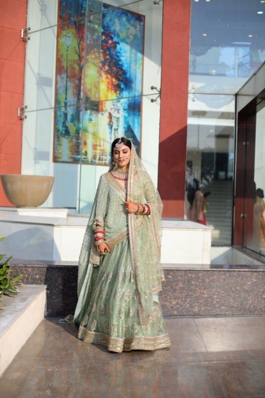 green pastel lehenga | close of indian bride | indian bridal jewllerey | wittyvows | chooda designs | nude makeup look destination wedding