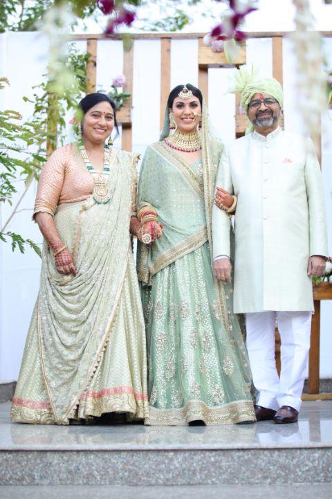 india wedding   indian bride   wittyvows   mother daughter moment   green pastel wedding   pastel lehenga   funny couple moments green sabyasachi lehenga   indian bride groom   wittyvows   bridal lehenga   floral wedding   chomu palace