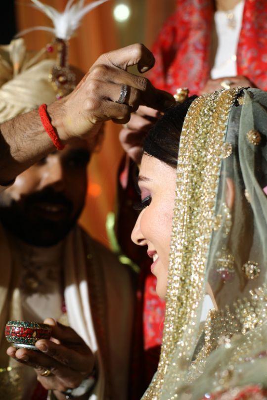 sindoor moments   cute candid moements at weddings   green sabyasachi lehenga   chomu palace   floral wedding