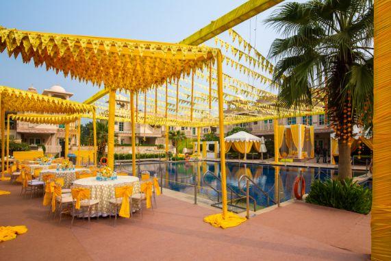 pool side wedding | indian wedding pool side | destination wedding outside delhi | haldi ceremony | floral decoratioms | indian parents and bride | realwedding |