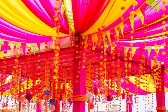tent decoration ideas for mehendi function | floral decor ideas | real weddings | #indianwedding #wittyvows | destination wedding Kitsch mehendi decor Decor ideas | colourful decor