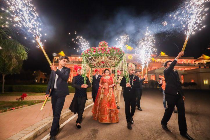 bridal entry | decor ideas | wedding couple indian bride in red lehenga | Kitsch mehendi decor | destination wedding Kitsch mehendi decor
