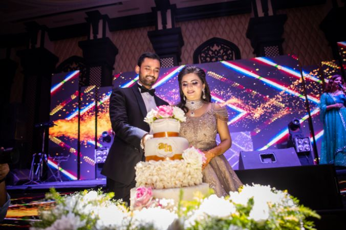 indian couple cake cutting | engagement cocktail night real wedding