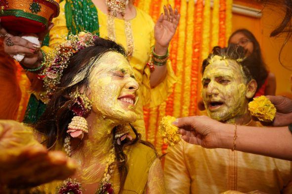 brides haldi ceremony   indian bride immersed in haldi