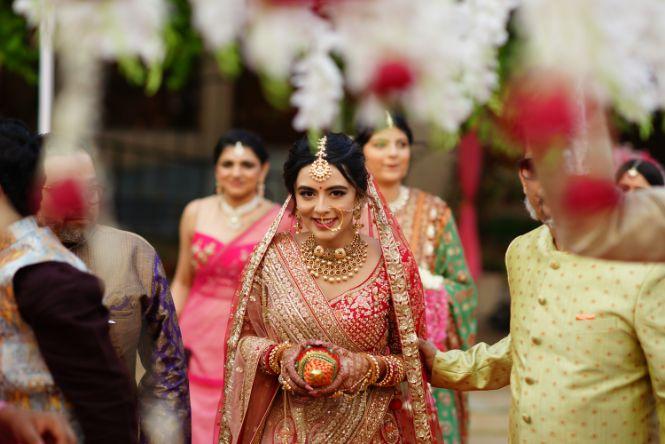 indian bridal entering her wedding day | Prettiest Mumbai Wedding