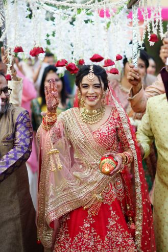 stunning bride entry   indian bridal dupatta drape ideas   Prettiest Mumbai Wedding