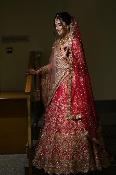 stunning red lwhwnga for the bride   indian wedding diaries   Prettiest Mumbai Wedding