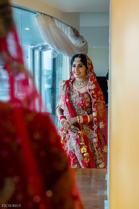 indian bridal shots indian couple posing Mumbai wedding manish malhora lehenga | indian bridal red lehenga | indian  couple black and white  #wittyvows #indianwedding