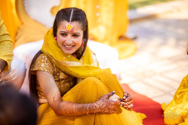 beautiful bride in yellow outfit for her haldi ceremony | Cutest Haldi Ceremony