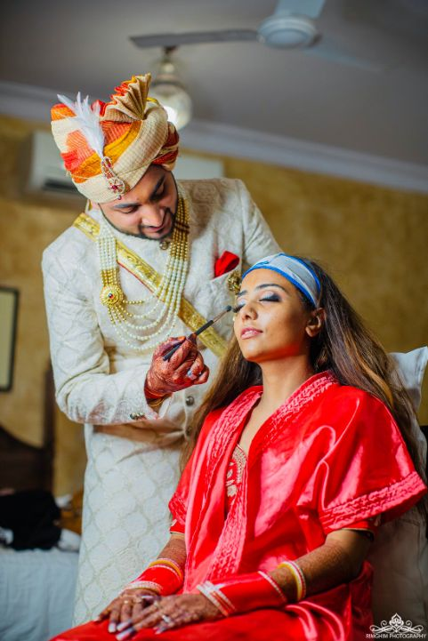 indian bridal makeup | funky photoshoots | indian couple kising | indian wedding | destination real wedding Destination wedding in jodhpur | indian wedding | colourful lehenga | halid shot | haldi shower | indian bride | wittyvows | #haldi #weddings #indianwedding #yellow #lehenga