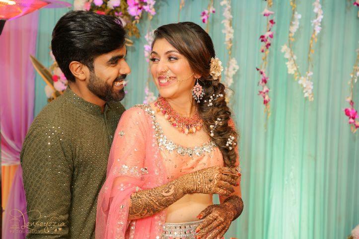 mehendi outfits   indian wedding mehendi scene   mehendi designs   green sabyasachi lehenga   chomu palace   floral wedding
