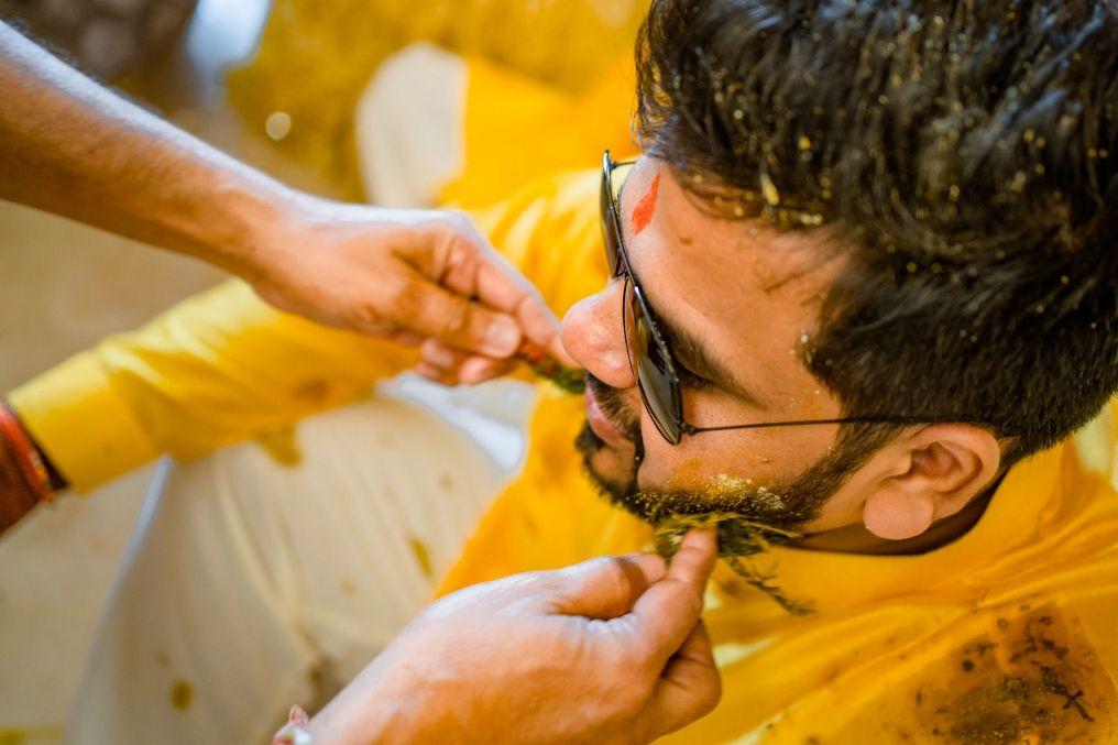indian groom, flower shower , haldi shower , candid photography , couple wedding moments , haldi ceremony