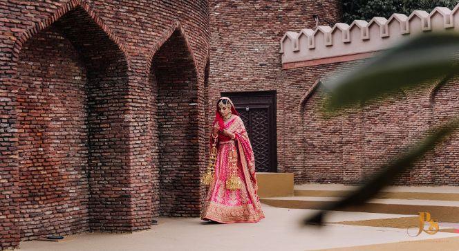indian bridal lehenga in pink , indian bride in pinklehenga , chooda designs , Punjabi bride | Mehendi outfit | bridal lehenga | Indian veil