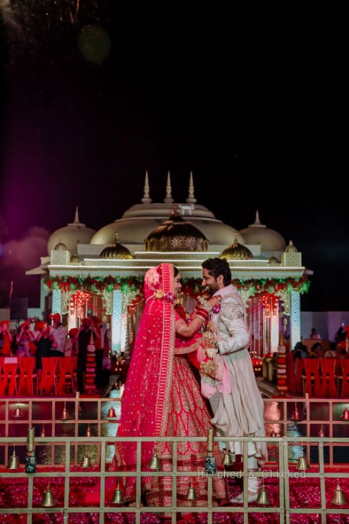 indian bridal wedding entry | sabyasachi bride , sabyasachi lehenga , red bridal lehenga , wedding decor , indian wedding | decor ideas for weddings , destination wedding , wedding at Fairmont, Fairmont Jaipur, Mehendi decor ideas, wedding entry