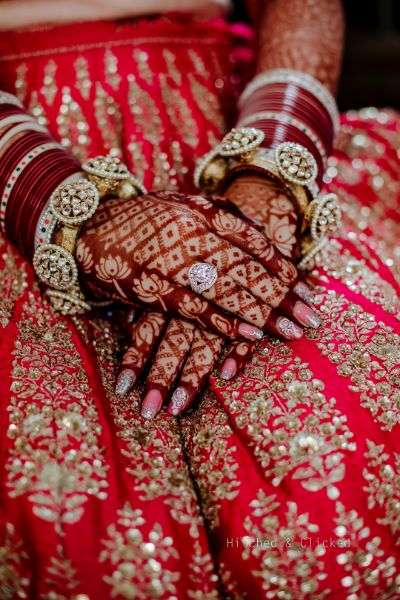 sabyasachi bride , sabyasachi lehenga , red bridal lehenga , wedding decor , indian wedding   decor ideas for weddings , destination wedding , wedding at Fairmont, Fairmont Jaipur, Mehendi decor ideas, wedding entry