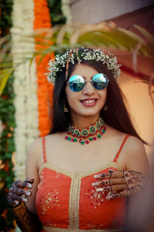 happy bride   brides in shades   mehendi look   henna designs   bridal seat in flowers   summer wedding   delhi wedding