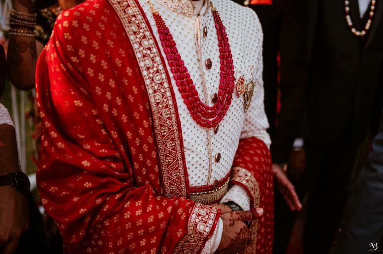 bridal details , indian groom , bridal portrait , red lehenga , couple kissing , indian groom , Rajasthani wedding   DIY lehenga design   Bridal hairdo   footear   boss bride customised   wittyvows real wedding  