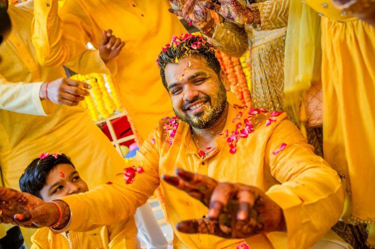 flower shower , haldi shower , candid photography , couple wedding moments , haldi ceremony