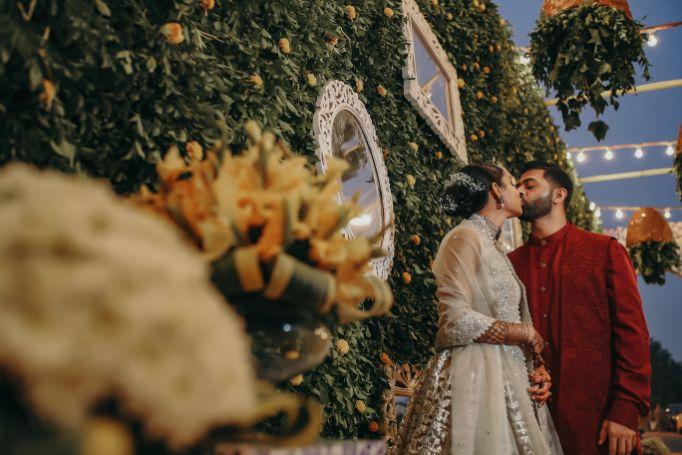 indian couple kissing , couple goals , indian bride and groom , indian couple kissing | indian wedding , wittyvows , wedding blog , wedding decor Moroccan theme mehendi mehendi decor