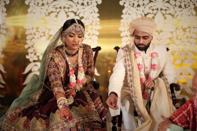 indian couple moments , indian wedding , wittyvows , varmala , phera moments , gujrati wedding