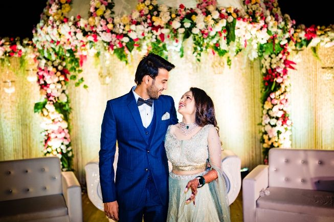 couple candid shots , bride hairstyle , floral hairstyle , indian wedding , indian bride , indian groom , hairstyle ideas, bridal hairdo