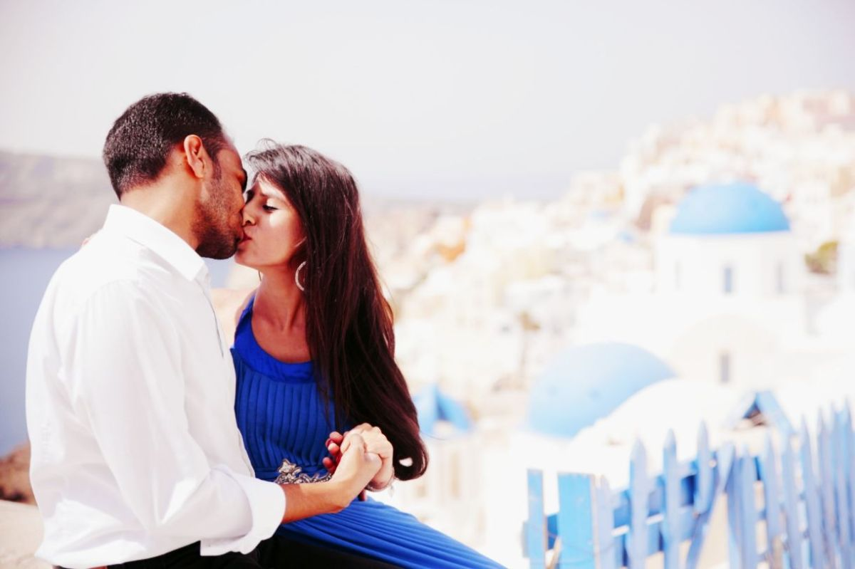 indian couple kiss , destination pre wedding shoot , greece , indian pre wedding shoot , indian wedding , wedding blog , indian couple , wittyvows , lehenga , indian bride off shoulder gown | mehendi outfit | pre wedding shoot in greece , pink chooda