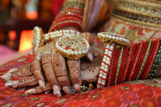 bridal details , ring , hands , mehendi hands , hennna hands with rings , wittyvows candid couple , happy couple , cheeks pulling , indian couple , wittyvows , weddings , indian bride , bridal lehenga , Lockdown wedding | intimate wedding | Wedding at home