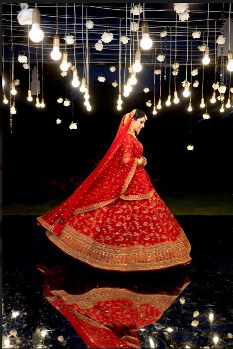 twirling , bridal twirl , couple , wedding couple , sabyasachi bride , red lehenga , wittyvows , real weddings 2020 , Red Sabyasachi lehenga and phoolon ki chadar