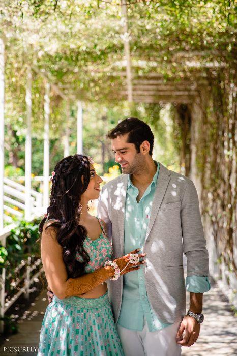 mehendi look , beachside mehendi , red lehenga , couple photoshoot , red chooda , wittyvows , indian bridesmaid , indian groomsmen , destination wedding   wedding in Goa   beachside mandap   mehndi look