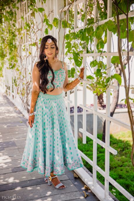 blue coral lehenga , bridal lehenga , mehendi outfit , indian wedding , india bride , wittyvows , weddings , goa wedding , destination wedding | wedding in Goa | beachside mandap | mehndi look ,mehndi