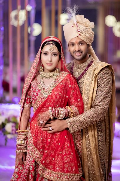 red lehenga , indian couple , yellow haldi , indian bridal fashion , wittyvows , wedding blog , 2020 weddings , Dhoti pants and pink lehenga as her reception outfit
