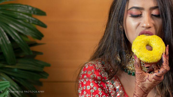 foodie bride , love for doughnut , brides with food , bridechilla , indain wedding , corona bride , mask fashion , bridal masks , indian weddings , hill station wedding | wedding in Saputara | bridal shoot