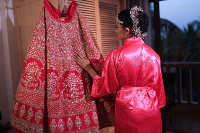 lehenga pose , bride with lehenga , sabyasachi red lehenga , wittyvows , gaurav gupta gown , Indian bride , weddings , big fat indian wedding , red lehenga , sabyasachi bride indian destination wedding , lakeside wedding | wedding in hua hin | bridal entry in a boat