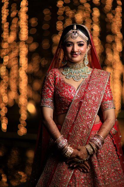 Indian bride , weddings , big fat indian wedding , red lehenga , sabyasachi bride indian destination wedding , lakeside wedding | wedding in hua hin | bridal entry in a boat