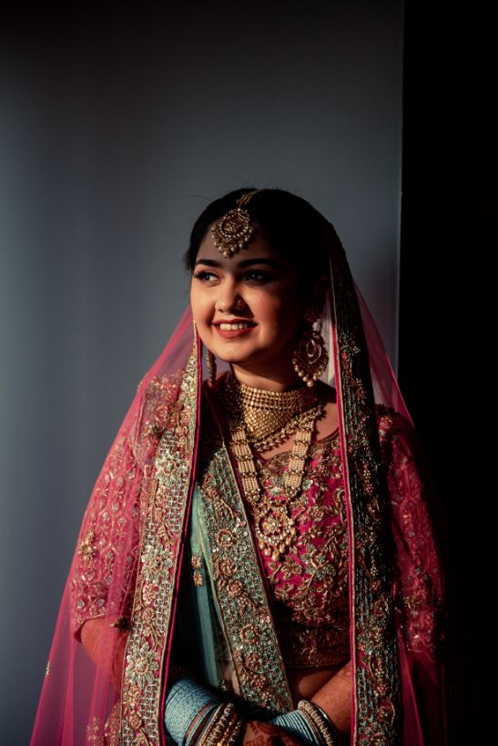 indian bridal portrait , Pink lehenga | blouse design | cross cultural wedding | wedding in delhi