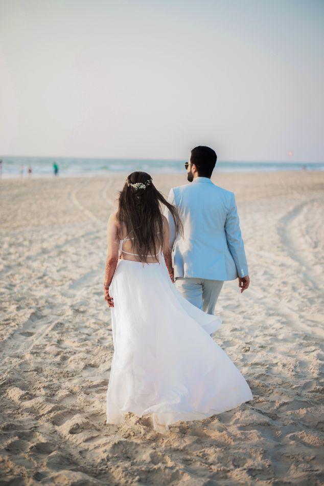goa wedding , beach wedding couple hand holding , all white , destination weddings , wittyvows , wedding blog Beach wedding | wedding in Goa | cocktail outfit | beach party