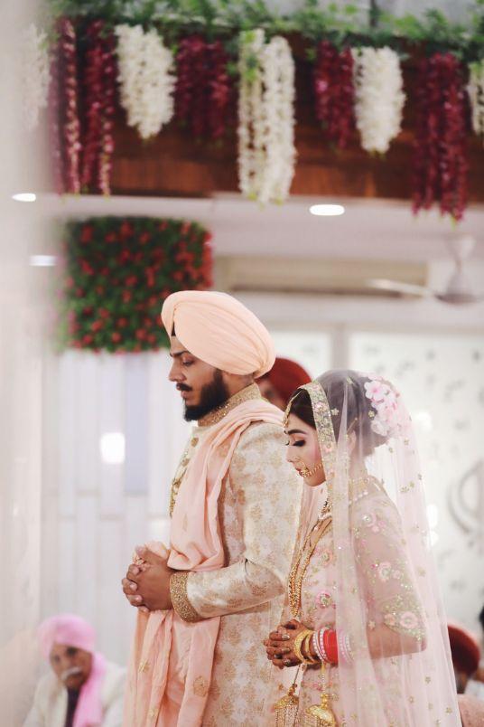 sikh weddings , , floral jewellery, haldi mehendi outfit , indian punjabi Wedding , weddings 2020 , red lehenga , pastel wedding | engagement lehenga | lehenga in red