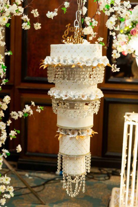 indian wedding cake ,  pastel wedding, grand wedding cake Chandelier cake, wittyvows , wedding blog , indian couple