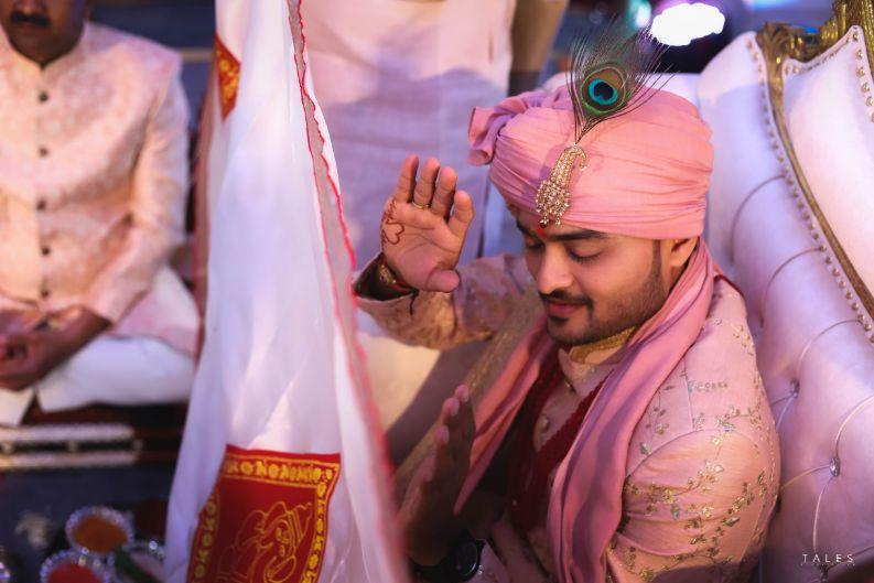 indian groom , bridal looks , wedding look , red lehenga , bridal mehendi , floral hands , floral jewellery , intimate wedding, personalised wedding ideas