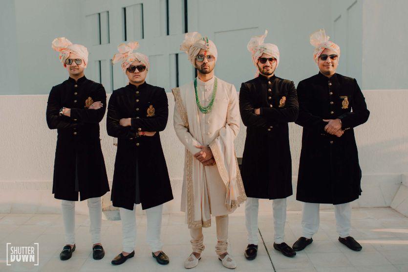 indian groom posing with grooms men   Destination wedding in Fujairah