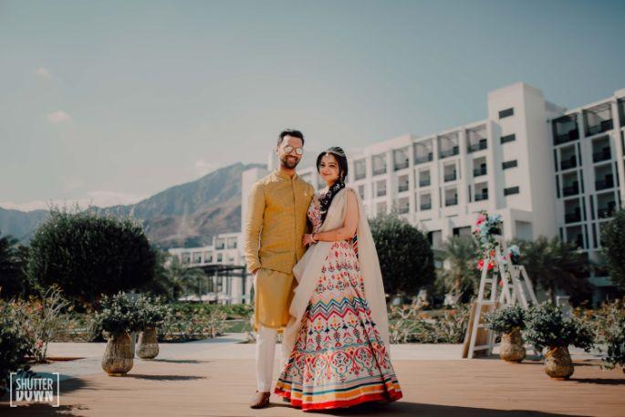 indian couple posing for their mehendi photos