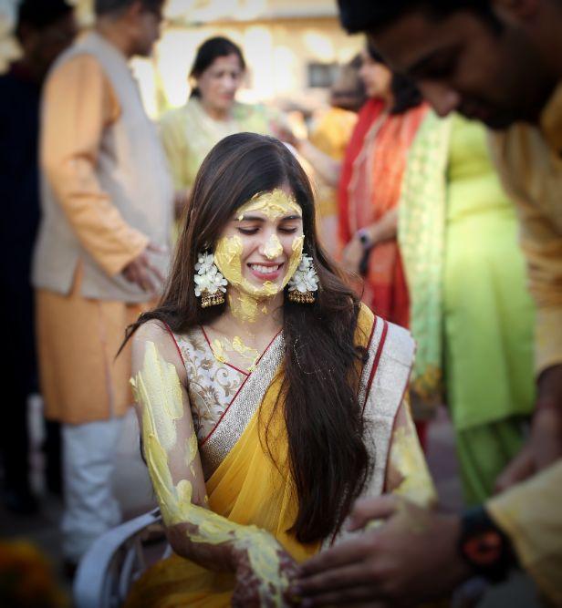 bride wearing saree for her haldi ceremony