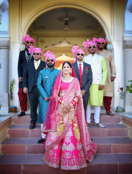 indian bride posing with her brothers