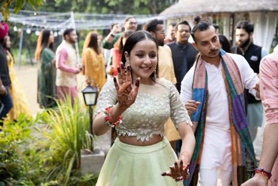 indian bridal entry ideas | bride dancing her way to the entry |