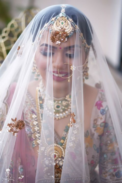 beautuful bride in pastel pink lehenga | bridal veil shots | Beach Wedding in Alibaugh