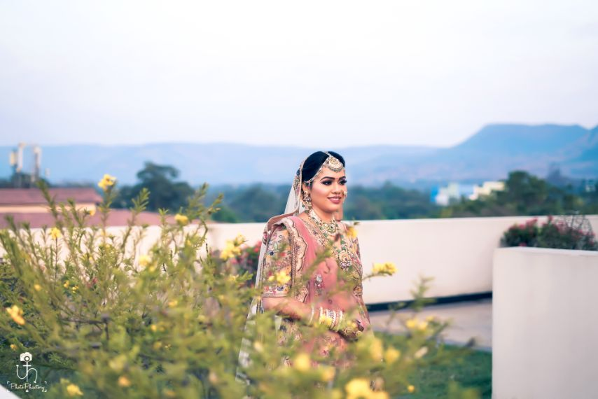 bridal shoot ideas | bride in pretty pink lehenga | Beach Wedding in Alibaugh