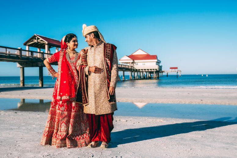 indian bridesmaid , red lehenga , indain family at weddings , NRI wedding   long-distance love story