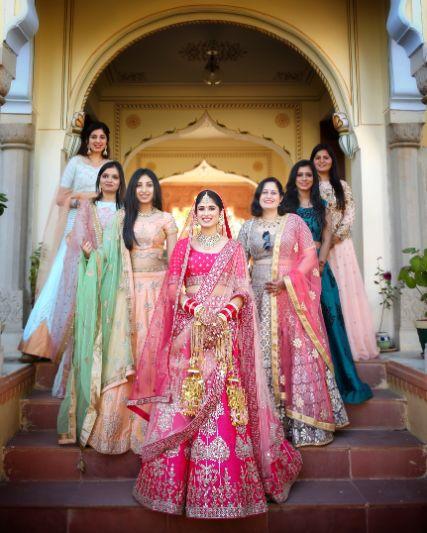 bride posing with her beautiful bridesmaids